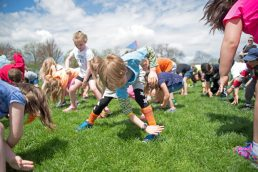 First graders from Brook Park School participate in exercises during their turn outside for a walkathon, one of several events planned by the Brook Park Council to raise funds for a new playground at the soon-to-be expanded school. | Alexa Rogals/Staff Photographer