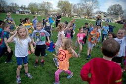 Students warm up before walking during their turn outside for a walkathon, one of several events planned by the Brook Park Council to raise funds for a new playground at the soon-to-be expanded school. | Alexa Rogals/Staff Photographer