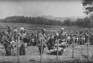 Top commanders, including Major Gen. Charles T. Menoher, Col. Douglas MacArthur and French generals Dupont and Penet lay flowers on the graves of 42nd Division soldiers killed May 27, 1918 on Decoration Day, May 30 at the military cemetery in Baccarat, France.   U.S. Army Signal Corps movie still, courtesy of National Archives