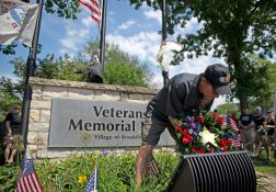 William Harris (above) laid a Gold Star wreath in memory of his son, Joshua, who was killed in Afghanistan in 2008. | Alexa Rogals/Staff Photographer