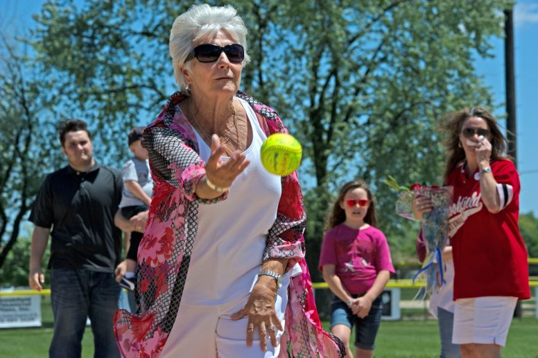 Mary Margaret Hull, wife of the late Dan Hull, throws out the first pitch to officially christen Dan Hull Field in Ehlert Park during a dedication ceremony honoring the former Little League World Series-winning softball coach in Brookfield on June 3. | Alexa Rogals/Staff Photographer