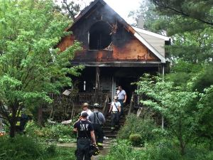 Firefighters assess the damage to 4312 Arthur Ave. after extinguishing the fire, which killed a woman who lived there, on June 10 in Brookfield. (Photo by Bob Uphues   Staff)