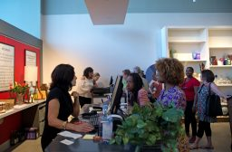 Customers line up to check out of the store on June 7, during the grand opening party at Divine Consign on Harlem Avenue in North Riverside. | Alexa Rogals/Staff Photographer