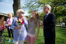 Retiring teacher Judy Sayre, left, stands near her daughter Morgan Sayre and husband Kimm Sayre on May 17 during a sculpture unveiling and surprise butterfly release at Blythe Park School in Riverside.   Alexa Rogals/Staff Photographer
