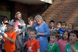 Retiring teacher Judy Sayre wipes away tears on May 17 during a sculpture unveiling and surprise butterfly release at Blythe Park School in Riverside.   Alexa Rogals/Staff Photographer