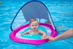 A child floats in a tube on June 14, at the Riverside Swim Club on Bloomingbank Road in Riverside. | Alexa Rogals/Staff Photographer