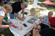Attendees fill out raffle tickets for the split the pot on Aug. 4, during the 102nd annual picnic at the Caledonia Senior Living and Memory Care in North Riverside. | Alexa Rogals/Staff Photographer