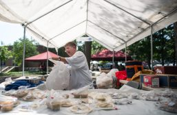 Sue Shuttleworth, of Brookfield, sells baked goods on Aug. 4, during the 102nd annual picnic at the Caledonia Senior Living and Memory Care in North Riverside. | Alexa Rogals/Staff Photographer