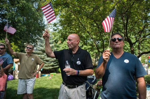 Supporters hold up American flags on Aug. 11, during a campaign rally in LaGrange. | Alexa Rogals/Staff Photographer