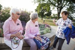 From left, Sis Popowitch, Janet Heisse, and Julia Malone, hang out outside with their MeToo stickers on Aug. 13, during a North Riverside Village board meeting at the Village Commons on Des Plaines Avenue. | Alexa Rogals/Staff Photographer