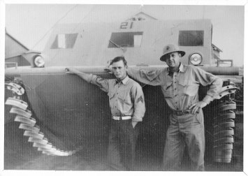 Bud Carlsen (right) and an unknown Marine stand in front of an LVT1 (landing vehicle, tracked), or amtrac. It was on an amtrac like this that Carlsen assaulted Red Beach on Betio Island on Nov. 20, 1943.| Photo provided