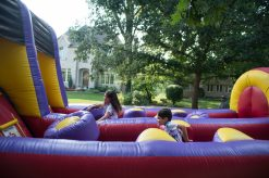 Kids race up the bounce house on Aug. 18, during the Maplewood Road 30th annual block party in Riverside. | Alexa Rogals/Staff Photographer