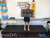 Isabelle Hlavaty beams as her picture is taken by her teacher, Brianna Kwasiborski, on the first day of kindergarten at Hollywood School. The day also included a 'teddy bear picnic' where kids and parents got to mingle and play. | PROVIDED