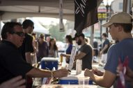 Guests try samples from dozens of breweries throughout the area on Aug. 25, during the Hop Stop Craft Beer Fest in downtown Riverside. | Alexa Rogals/Staff Photographer