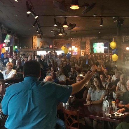 J.B Pritzker, foreground, spoke to more than 100 people gathered for a campaign appearance at the Brookfield Ale House on Aug. 28. (Photo courtesy of Meaghan McAteer)