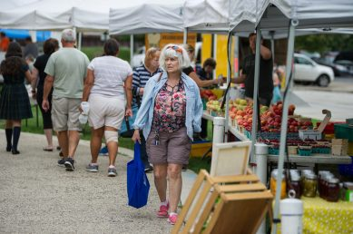 Patrons check out different vendors on Aug. 29, during the weekly farmers market in downtown Riverside. | Alexa Rogals/Staff Photographer