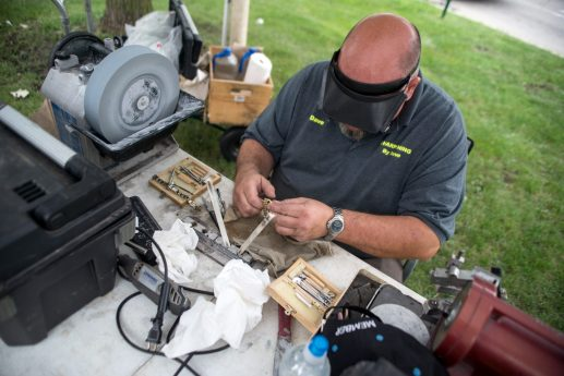 Dave Nells, owner of Sharpening with Dave, fixes a wristwatch on Aug. 29, during the weekly farmers market in downtown Riverside. | Alexa Rogals/Staff Photographer