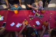 Kids decorate pumpkins on Sept. 14, during the annual Autumn Fest and Chili Cook-off at the North Riverside Village Commons. | Alexa Rogals/Staff Photographer
