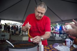 Ken Rouleau serves samples of chili on Sept. 14, during the annual Autumn Fest and Chili Cook-off at the North Riverside Village Commons. | Alexa Rogals/Staff Photographer