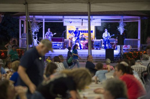 Attendees hang out under the tents and listen to live music on Sept. 14, during the annual Autumn Fest and Chili Cook-off at the North Riverside Village Commons. | Alexa Rogals/Staff Photographer