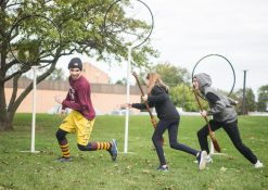 Parker Harris (left) plays the Snitch and is chased by Natalie Grover and John Vandonsel. | Alexa Rogals/Staff Photographer