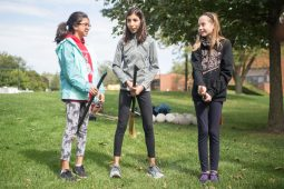 From left, Samira Giron, Sophia Singh and Natalie Grover listen to the rules on Sept. 29, during Quidditch outside of the North Riverside Village Commons on Des Plaines Avenue. | Alexa Rogals/Staff Photographer
