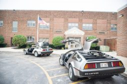 Two De Lorean's are seen parked in the front of the school on Oct. 5, during the walkathon inside the gymnasium at Congress Park School in Brookfield. | Alexa Rogals/Staff Photographer