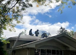 Firefighters cut holes in the roof of 3815 Madison Ave. in Brookfield to vent smoke that filled the house after a fire started in the basement. (Photo courtesy of the Brookfield Police Department)