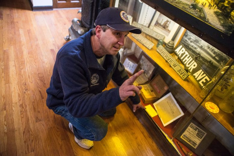 Museum director Kit Ketchmark points out items on display, which include old street signs, documents, photos, clothing, zoo memorabilia and even a 1905 fire department hose reel. | Alexa Rogals/Staff Photographer
