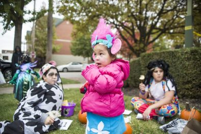 Maddie Padilla, 2, of Cicero, tries a piece of candy during the annual Monsters on Mainstreet trick-or-treating event on Oct. 27.   ALEXA ROGALS/Staff Photographer