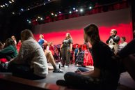 Students get on stage and warm up on Nov. 3, during dress rehearsals for Alice In Wonderland at Riverside Brookfield High School. | ALEXA ROGALS/Staff Photographer