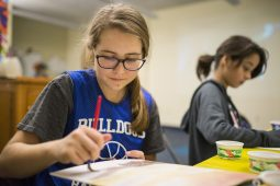 Paige Beggs, 14, of North Riverside, paints on Saturday, Nov. 10, 2018, during a teens DIY watercoloring event in the story time room at North Riverside Public Library. | ALEXA ROGALS/Staff Photographer