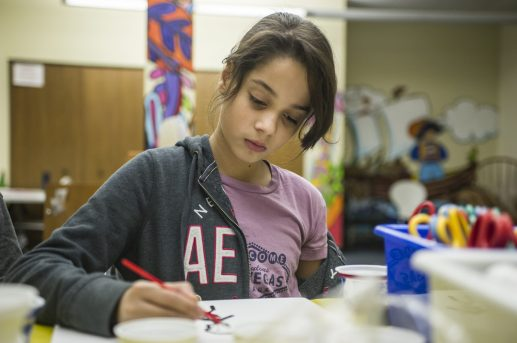 Angelina Figueroa, 12, of North Riverside, works on painting a picture on Saturday, Nov. 10, 2018, during a teens DIY watercoloring event in the story time room at North Riverside Public Library. | ALEXA ROGALS/Staff Photographer