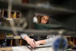 Celeste Wimmer-Loeffler cuts pieces of glass on Nov. 15, on Quincy Street in Riverside. | ALEXA ROGALS/Staff Photographer