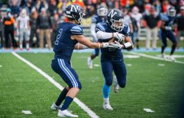 Nazareth quarterback J.J. McCarthy hands the ball off to running back Alex Carrillo. Both players, who were contributors this year, return next season for the 7A state champs. (File photo)