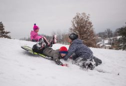 Kids crash on their sleds on Nov. 26, at the North Riverside Village Commons sledding hill on Des Plaines Avenue in North Riverside. | Alexa Rogals/Staff Photographer