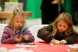 Ada Kuykendall, 4, left, and her sister, Mattie, 7, both of Brookfield make a craft on Dec. 1 at Village Hall as part of Brookfield's Holiday Celebration. | Photo by Sarah Minor