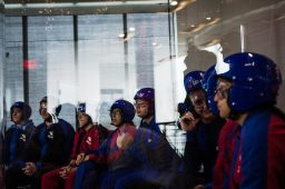 RBHS students wait for their turn to fly as their classmate is guided by a iFly instructor. | Sebastian Hidalgo/Contributor