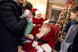 Children tell Santa and Mrs. Claus what's on their Christmas lists at Riverside Bank. | Alexa Rogals/Staff Photographer