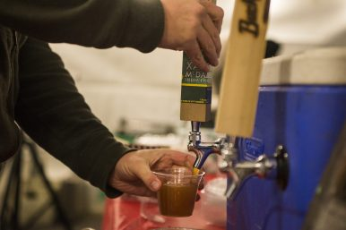 Attendees try free samples of BuckleDown Brewing beer on Dec. 7, during the 44th annual Chamber of Commerce Holiday Stroll in downtown Riverside. | Alexa Rogals/Staff Photographer