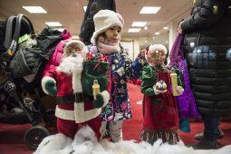 Families wait in line to take photos with Santa Claus Dec. 7, during the 44th annual Chamber of Commerce Holiday Stroll in downtown Riverside. | Alexa Rogals/Staff Photographer