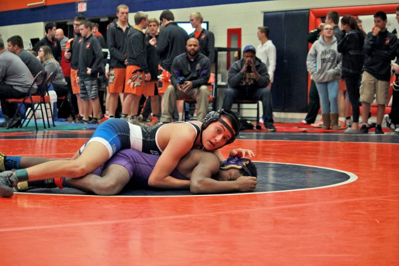 RBHS wrestler Cristian Vasquez takes control during a match. He typically wrestles in the 145-pound weight class and has eight wins this season. (Courtesy of Nick Curby)