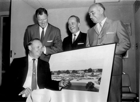 The silver screen's singing cowboy, Gene Autry (seated), points to a rendering of the Sahara Inn North during a press conference in June 1963 announcing he would buy the star-crossed hotel. Marshall Savings President Henry Moravec Sr. (far right) is all smiles about the deal.   Courtesy Liz Faron collection