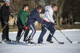 A group plays a hockey game on Saturday, Feb. 9, 2019, at the Big Ball Park ice rink in Riverside, Ill.   ALEXA ROGALS/Staff Photographer