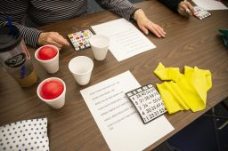 """Exercise bands and stress balls are seen on the table along with a list of exercises for attendees to do between games on Feb. 20, during """"Bingocize"""" at the North Riverside Public Library.   ALEXA ROGALS/Staff Photographer"""