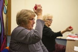 """Maryanne Burke, of North Riverside, holds a stress ball while doing arm curls between """"Bingo"""" games on Feb. 20, 2019, during Bingocize at the North Riverside Public Library.   ALEXA ROGALS/Staff Photographer"""