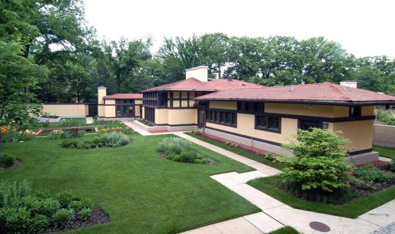The former coach house at the Frank Lloyd Wright-designed Coonley Estate has been completely renovated, fusing Wright's landmark Prairie Style with contemporary living. The private garden (shown above) is an oasis. (Courtesy of Baird & Warner)