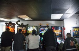 Among the rare, horror movie-themed games available to play at Galloping Ghost Pinball Arcade are (from left) Freddy: A Nightmare on Elm Street, Creature from the Black Lagoon, Godzilla, Alien and - one of the rarest of all - the prototype for Predator. | Alexa Rogals/Staff Photographer