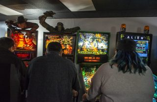 Attendees play pinball on March 2, during the opening night of Galloping Ghost's Pinball Arcade on Ogden Avenue in Brookfield. | ALEXA ROGALS/Staff Photographer