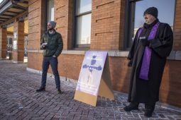 """Rev. Chris Honig (left) of Ascension Lutheran Church, and Rev. Dale Jackson, of Riverside Presbyterian Church, offered """"ashes to go"""" to the faithful on Ash Wednesday, March 6, at the Riverside train station.   ALEXA ROGALS/Staff Photographer"""